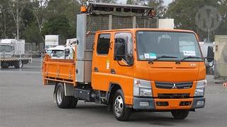 2012 Fuso Canter 515 Tipper With Maxilift NJ110 Handi Crane & Arrow Board**Sold without # plates** G Photo