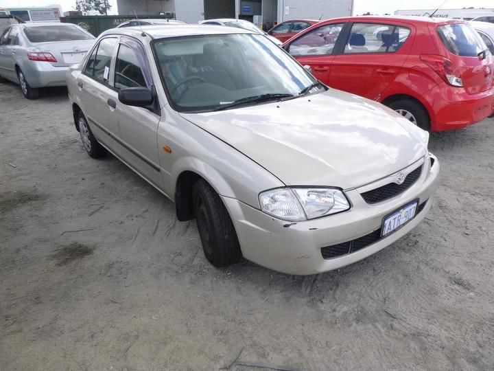 damaged 2000 mazda 323 protege sedan for auction in perth int'l