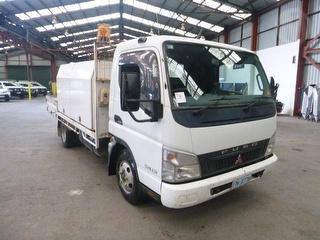 2006 Fuso Canter Tray GVM 6,500kg Photo