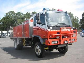 2006 Isuzu FTS750 Fire truck F/W water tank,pump & hose reels,lock up boxes GVM 13,000kg Photo