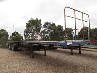 1990 Southern Cross Standard Triaxle Flat Top Trailer ATM 20,000kg Photo